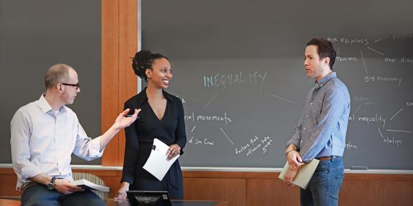 professors talking to student